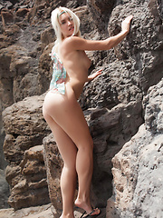 Cristina\'s delicate, slender body, undeniably pretty face, and refreshing personality is a pleasing break from the rugged rocks and desolate beach on her background. - Erotic and nude pussy pics at GirlSoftcore.com