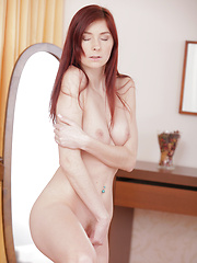 Stunning redhead Kattie Gold massages her magnificent tits and then moans as she pleasures her soft shaved creamy pussy - Erotic and nude pussy pics at GirlSoftcore.com