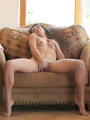 Exotic beauty fingers her puffy pussy until she cums - Erotic and nude pussy pics at GirlSoftcore.com