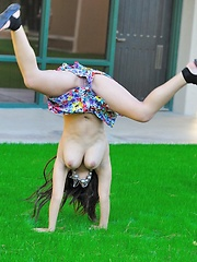 Leila does cartwheels topless outside - Erotic and nude pussy pics at GirlSoftcore.com