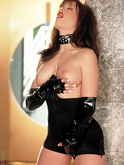 Lucy Lvette - Black suit with leather gloves - Erotic and nude pussy pics at GirlSoftcore.com