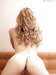This stunning slim blonde angel takes off her hot bikini and later teases without clothes on a king sized bed. - Erotic and nude pussy pics at GirlSoftcore.com
