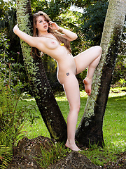 Jessi June caresses her sexy body at the garden - Erotic and nude pussy pics at GirlSoftcore.com