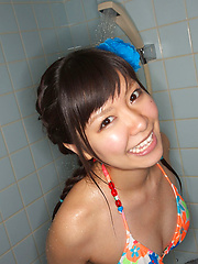 Sweet Ayana Tanigaki smiles and poses at the kitchen with banana - Erotic and nude pussy pics at GirlSoftcore.com