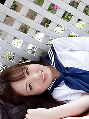 Maho Kimura Asian undresses school uniform right in the park - Erotic and nude pussy pics at GirlSoftcore.com