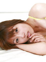 Shizuka Sakura Asian with hot cans and ass in yellow goes to sea - Erotic and nude pussy pics at GirlSoftcore.com