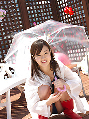 Kana Yuuki Asian in bath suit plays with umbrella in the balcony - Erotic and nude pussy pics at GirlSoftcore.com