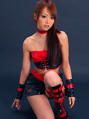 Momoka Narushima Asian looks best in red and black latex outfit - Erotic and nude pussy pics at GirlSoftcore.com