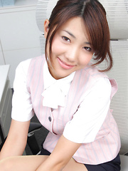 Naoho Ichihashi Asian in fancy outfit sits with ass on the office - Erotic and nude pussy pics at GirlSoftcore.com