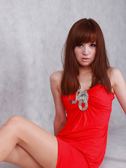 Sandy Asian in red dress is so leering touching her sexy lips - Erotic and nude pussy pics at GirlSoftcore.com