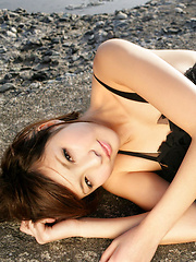 Rina Nagasaki Asian in see through lingerie shows legs on rocks - Erotic and nude pussy pics at GirlSoftcore.com