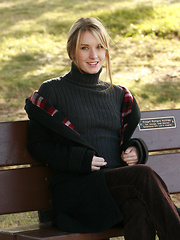 Preppy schoolgirl shows off her bush in the park - Erotic and nude pussy pics at GirlSoftcore.com