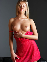 A red lingerie dress amplifies Barbara's sensual appeal while showcasing her body's feminine curves. - Erotic and nude pussy pics at GirlSoftcore.com