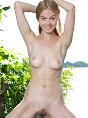 With her pretty girl-next-door allure, Nancy A is a delightfully refreshing view as she enthusiastically poses by the lake, showcasing her beautiful nubile body. - Erotic and nude pussy pics at GirlSoftcore.com