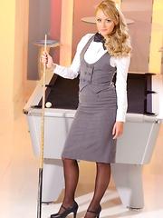 Pool hustler Sara wearing tight fitting skirt suit and black stockings
