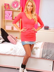 HM looks wonderful in a short denim mini with black sheer pantyhose. (Non Nude)