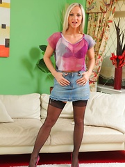 Tammy looks hot as she strips out of her short denim skirt