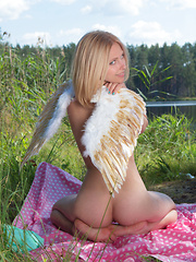 Amazing blonde teen babe gets naked on the lap of nature and tries to mimic some angelic beauty with her poses. - Erotic and nude pussy pics at GirlSoftcore.com