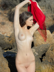 Stunning brunette beauty shows that not even the ocean can match the waves of lust clashing inside her shapely body. - Erotic and nude pussy pics at GirlSoftcore.com