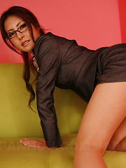 Sexy brunette Julia Nanase bends over couch - Erotic and nude pussy pics at GirlSoftcore.com