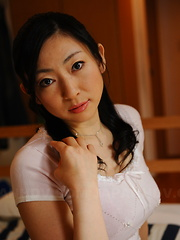 Hot babe Emiko Koike provokes with her gown - Erotic and nude pussy pics at GirlSoftcore.com