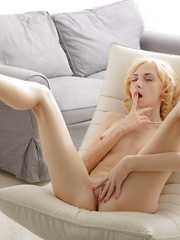Beautiful blonde gal fucks her yummy pussy with fingers - Erotic and nude pussy pics at GirlSoftcore.com
