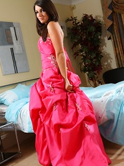 Dark haired stunner hides sexy pink lingerie and sheer stockings beneath her prom dress.