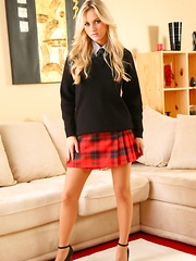 Blonde strips out of her college uniform in the lounge.
