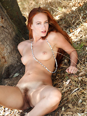 Elegant Sally A flips around her beautiful crimson hair then sliding out of her little knit dress to present her perfect breasts and hairy pussy. - Erotic and nude pussy pics at GirlSoftcore.com