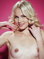 Set against a bubblegum pink background, the luscious blonde Cordelia A puts on a exciting show, teasing and posing with a smile on her pretty face.