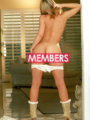 Ashley Brookes - White robe with white pantys in the doorway - Erotic and nude pussy pics at GirlSoftcore.com