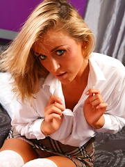 Curvy blonde college girl in a tight white shirt and cardigan - Erotic and nude pussy pics at GirlSoftcore.com