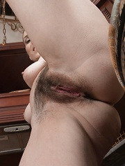 Donatella strips and oils up her hairy body - Erotic and nude pussy pics at GirlSoftcore.com