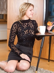 Ayda strips while enjoying her breakfast - Erotic and nude pussy pics at GirlSoftcore.com