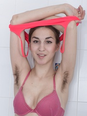 Halmia takes a soapy and wet bath in her bathroom - Erotic and nude pussy pics at GirlSoftcore.com