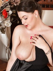 The classy Cherry Blush strips naked on her chair - Erotic and nude pussy pics at GirlSoftcore.com