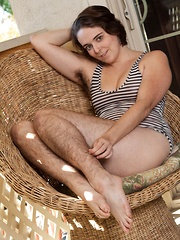 Harley strips naked from a bodysuit on chair - Erotic and nude pussy pics at GirlSoftcore.com