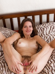 Flowers and stripping makes Lulu horny in bed - Erotic and nude pussy pics at GirlSoftcore.com