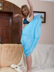 Alisia undresses from blue lingerie on chair - Erotic and nude pussy pics at GirlSoftcore.com
