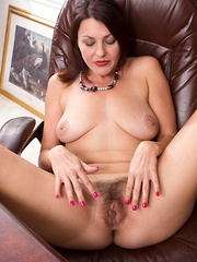 Gina Louise strips by her desk and shows her pussy - Erotic and nude pussy pics at GirlSoftcore.com