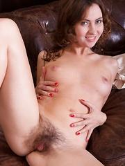 Vita strips naked and masturbates near her sofa - Erotic and nude pussy pics at GirlSoftcore.com