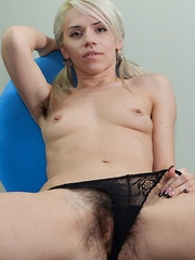 Hairy woman Selena enjoys stripping and playing - Erotic and nude pussy pics at GirlSoftcore.com