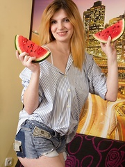 Terry eats watermelon and then undresses to relax - Erotic and nude pussy pics at GirlSoftcore.com