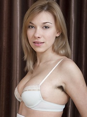 Alisia strips from her dress and stockings on bed - Erotic and nude pussy pics at GirlSoftcore.com