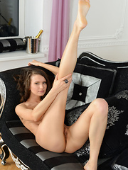 This lovely brunette strips all her clothes to show a piece of her mind blowing tight pussy on her couch at home. - Erotic and nude pussy pics at GirlSoftcore.com