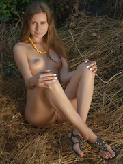 Let her shine that sexy light on you while clothes keep slipping of that perfect body one by one to please you to the max. - Erotic and nude pussy pics at GirlSoftcore.com