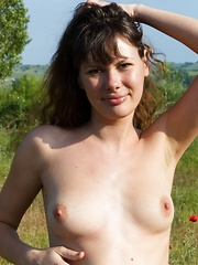 Hairy babe Rimma loves to walk through flowers - Erotic and nude pussy pics at GirlSoftcore.com