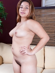 Voluptuous Daisy Leon shows off her hairy pussy - Erotic and nude pussy pics at GirlSoftcore.com
