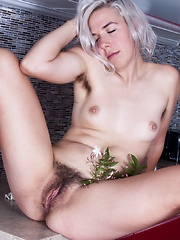 Hairy woman Cordelia strips in the kitchen