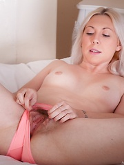 Alison Colins playing with hairy pussy on bed - Erotic and nude pussy pics at GirlSoftcore.com